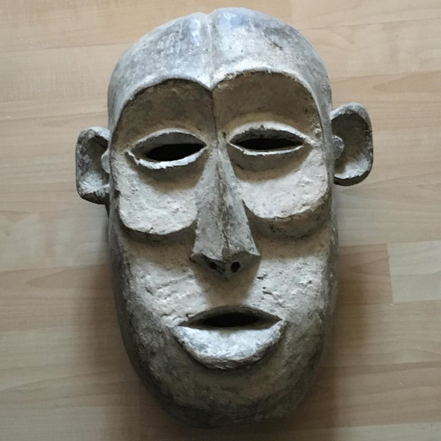 African Tribal hand carved mask. Please look at images carefully for wear over the years. This mask has been in a non-...