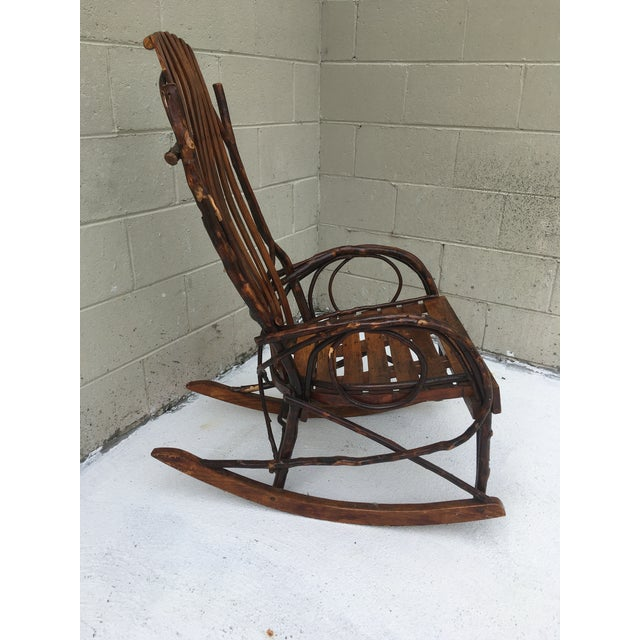 Lovely vintage bent wood rocker, this adds a sculptural yet organic look to a room! Would be fine on a porch too as long...