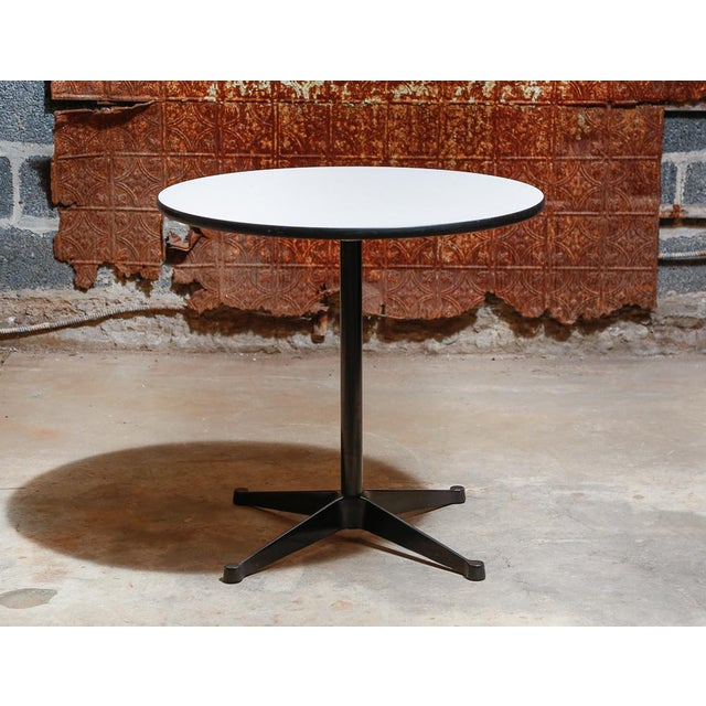 Herman Miller Eames Circular Pedestal Table With Grey And White Speckle Pattern Laminate Top