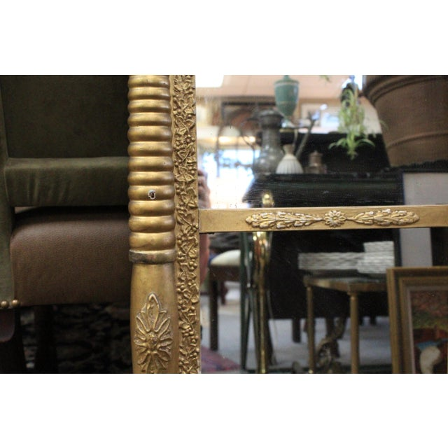 Tall rectangular art nouveau 2 sectioned mirror in painted gold wood. A beautiful accent piece!