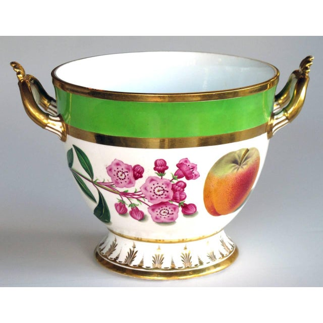 A good quality Paris Porcelain polychromed double-handled cache pot/jardiniere; the cup-shaped bowl raised on a flared...
