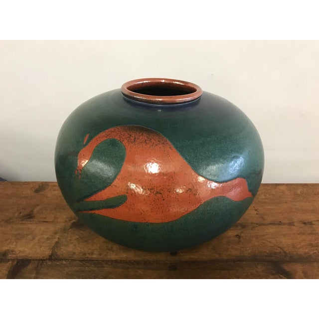 Stunning globular form water jar or vase depicting an American Indian informed stylized horse in reddish brown upon a...