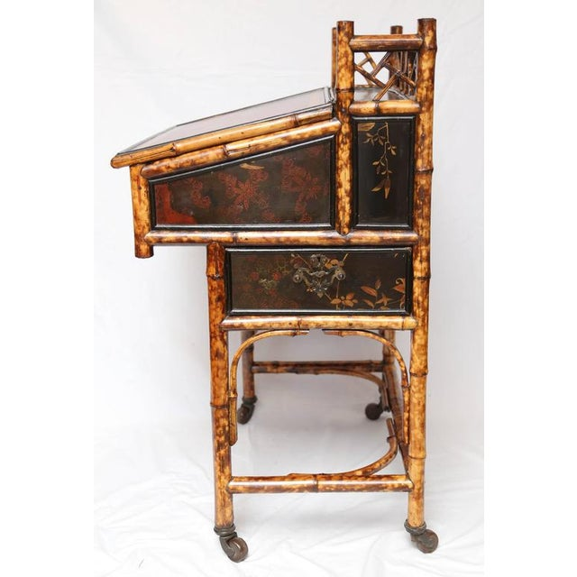 A beautiful 19th century English bamboo desk Davenport with a compartment for storage enclosed by a leather clad front...