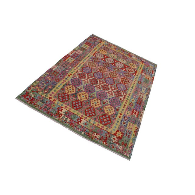 """Add a touch of elegance to your home with this casual chic hand woven Tribal Kilim wool rug. Constructed on a loom by..."