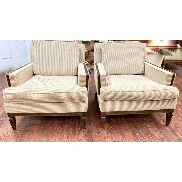 A fab pair of mid century club chairs. We love the dark wood trim on the arms and the carved legs. Deep seat and...