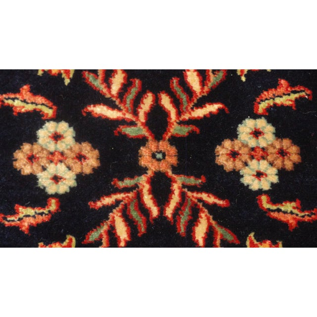 Add some ethnic elegance to your entryway or hall with this antique Indian Sarouk runner rug. It was handmade in rich,...