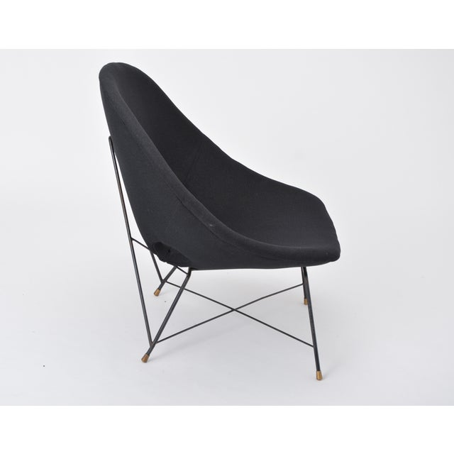 Rare Cosmos lounge chair designed by Augusto Bozzi for Saporiti Italia, Italy, 1954. This chair has a black lacquered...