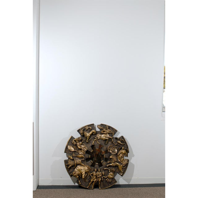 A Wonderful Brutalist style Zodiac mirror by Finesse Originals, circa 1970's. Cast resin with a custom bronze finish....
