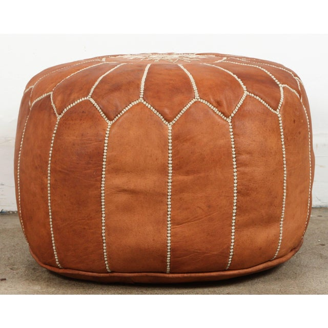 Moroccan handcrafted camel leather ottoman, with embroideries. Could be used a foot stool, or side table or ottoman. The...