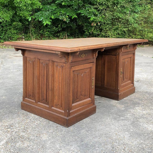 19th Century Gothic Oak Executive Desk was made by famed maker Emile Laurent-Durhesne of Liege, and features a restrained...