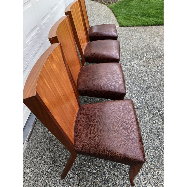 -Aldabhra side chair with mahogany veneered back. -Solid mahogany legs and arms. -Aubergine leather seat....