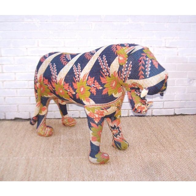Love this tiger soft sculpture covered in vintage kantha quilts which are a unique textile created from reclaimed saris....