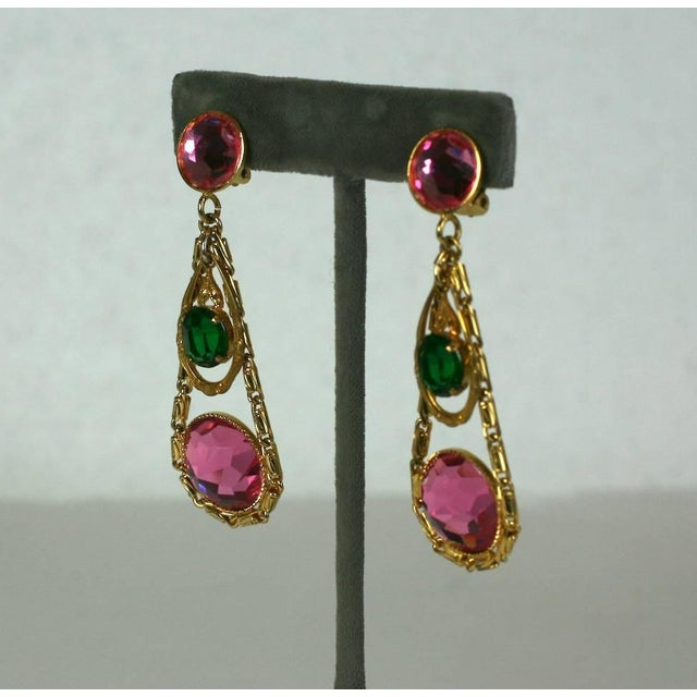 French long earrings in a Girandole style of faux pink tourmaline and emerald faceted, rose cut crystal. Earring pendants...
