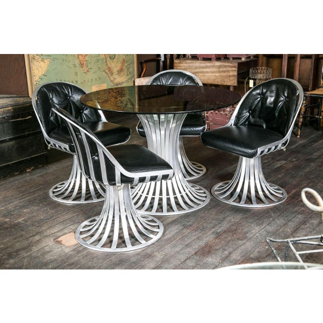 """Aluminum Russell woodard black tinted glass top table and chairs by Lee L. Woodard & Sons. Table is 42"""" diameter x 28.5""""..."""