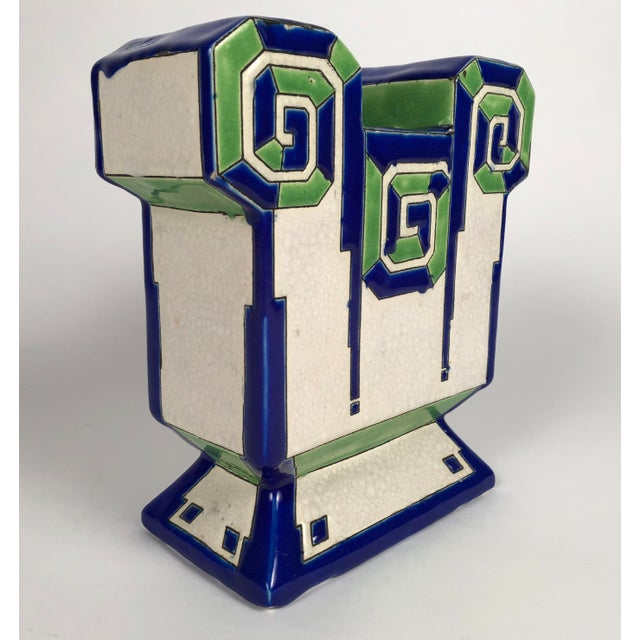 An Art Deco period ceramic vase by Boch Freres Keramis, of unusual geometric form, with two openings to hold flowers, of...