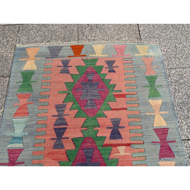 This is a vintage 100% wool Kilim rug. The piece was handmade and naturally dyed. Difference between anatolian Kilims and...