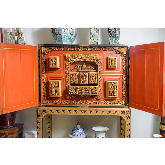 Beautiful, mid 19th century, Chinese, lacquered cabinet on stand. Interior very ornately carved with many drawers and fine...
