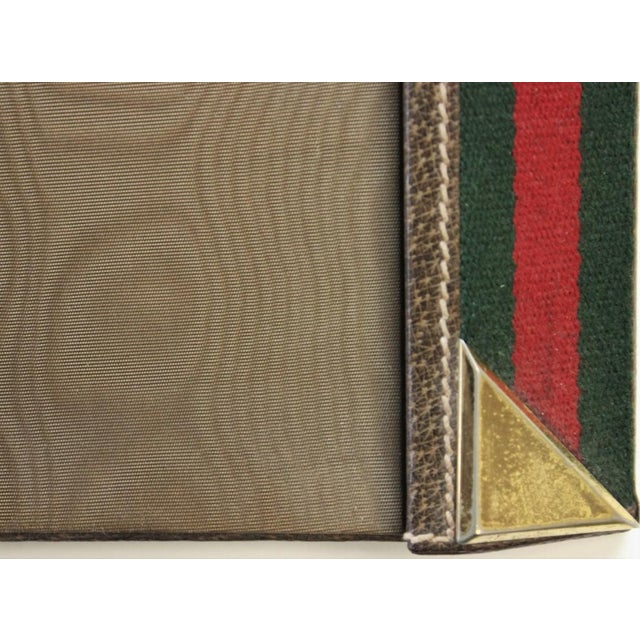 "Green and red Gucci desk blotter. Dimensions: 8 3/8""W x 8""H"