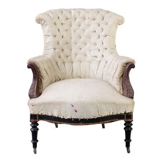Tufted French Armchair With Carved Details