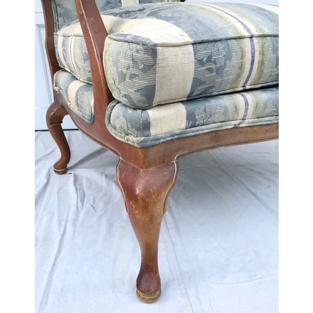 A superbly made cozy lounge chair by Thomasville. This chair has beautifully curved legs and scroll wood detailed arms....