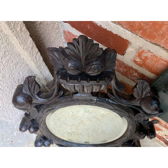 19th Century Antique English Black Forest Style Carved Dark Oak Oval Wall Mirror For Sale - Image 9 of 13