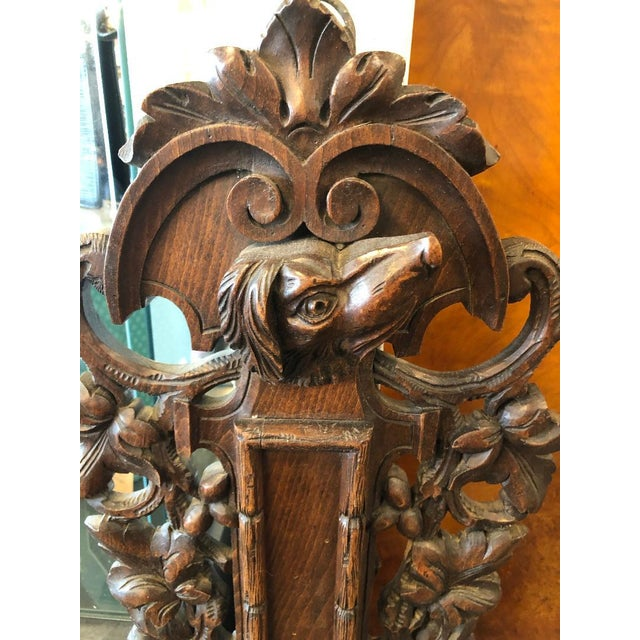 French Louis XIII black forest barometer with carved crossed shotgun and fowl hunting motif on bottom, framed with leaf...