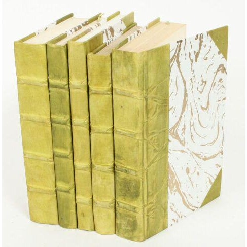 Various recycled English books rebound in a beautiful parchment paper with coordinating marble pattern hardback covers....