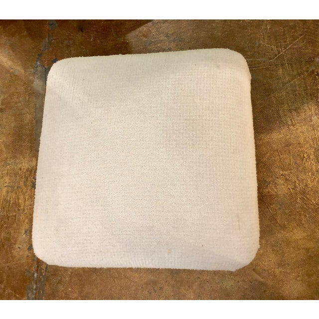 Karl Springer-style souffle ottoman in cream-toned boucle upholstery, which appears to be original. The ottoman truly...
