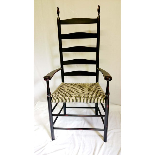 This is a reproduction of an antique Shaker Elder's Chair and is from the Shaker Workshops in Massachusetts. The chair is...