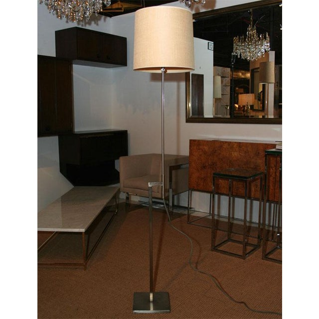 "A pair of adjustable height (44""-60"") floor lamps in square tubing and brushed steel finish by Laurel. American. circa 1960."