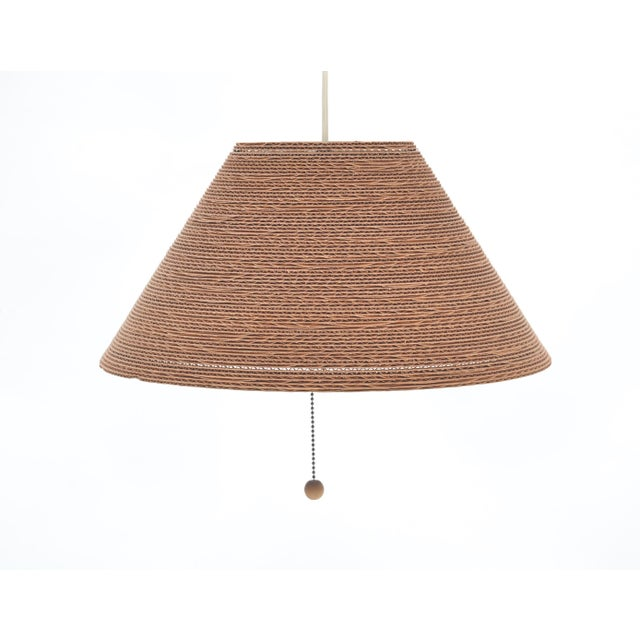 Constructed of layered cardboard in a Frank Gehry-esque manner. Light emits a warm glow. Currently wired with plug.