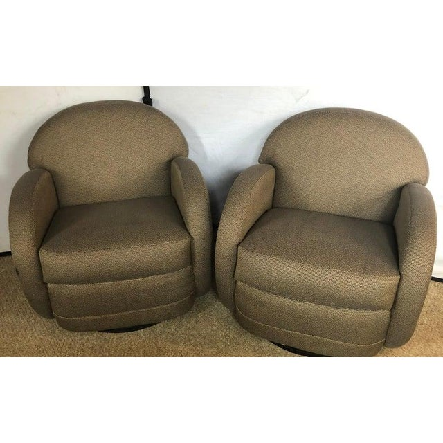 Pair of pace by Directional Leon Rosen style swivel lounge chairs. Told by the past owner that this Fine pair of swivel...