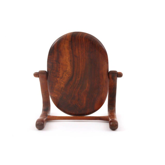 Studio cocobolo mirror, circa early 1960s. This sculptural example is adjustable and hand-formed. It is solid cocobolo...