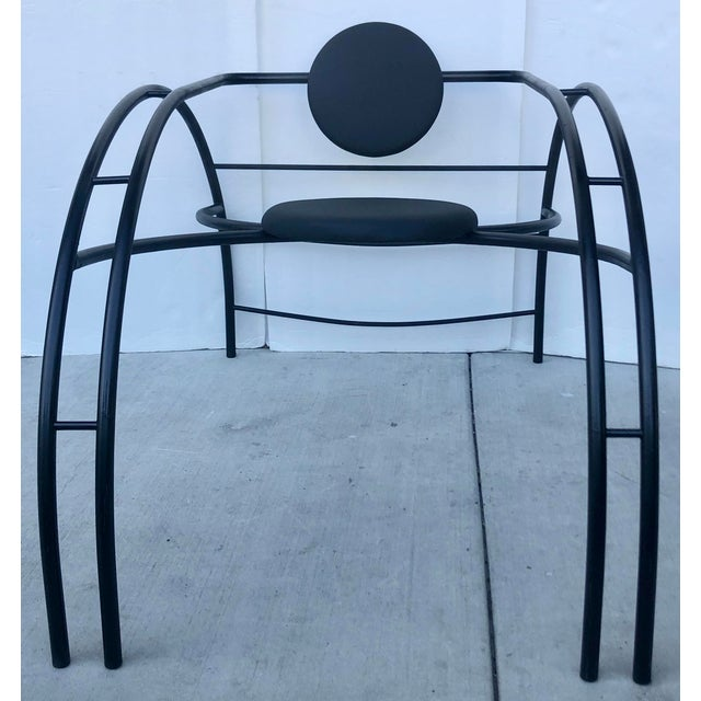 The Quebec 69 spider chair by Canadian postmodern Design Group Les Amisca featuring a bold exoskeleton of tubular steel,...