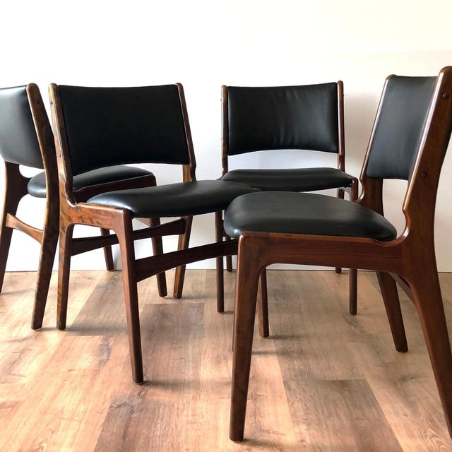 Restored with new cushions and newly-upholstered set of 4 Erik Buch dining chairs (model 89).