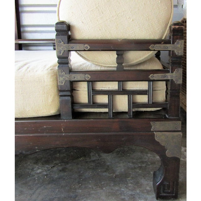 """Carved wood with decorative brass accents is ) this """"opium"""" day bed is great for cozy seating! The day bed is made of two..."""