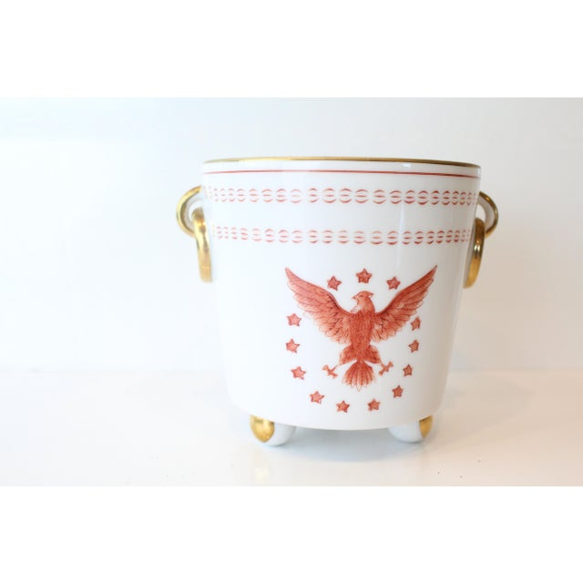 Beautiful regal white porcelain cache pot with gold and orange details.