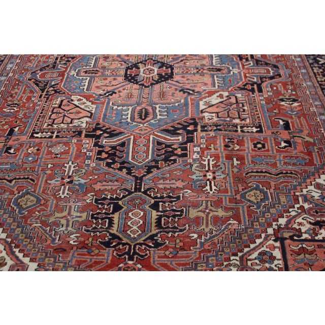 This stunning antique Heriz rug was hand knotted in 1920's in Iran. Knotted with 75% wool and 25% cotton, dyed with...