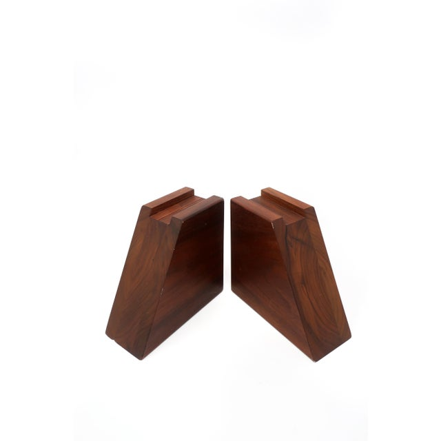 A pair of mid-century modern walnut bookends with one angled side and one with a channel cut into it. With two flat sides,...
