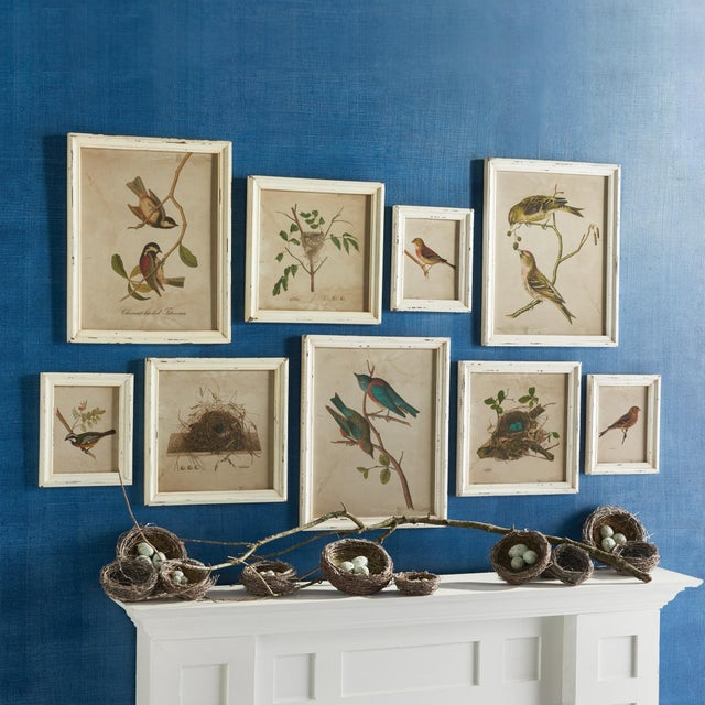 The varying sizes of this gallery style set creates instant high design for your wall. With bold colors and intricate...