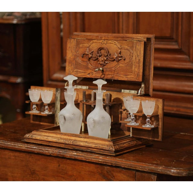 Created circa 1870, this antique liquor cabinet is an essential for an elegant bar area. Made in the French Alps, the cave...