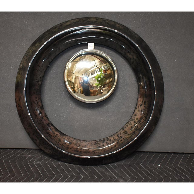 Round convex mirror cover with goatskin. Parchment is in varying shades of charcoal. (High gloss polyester resin filled...