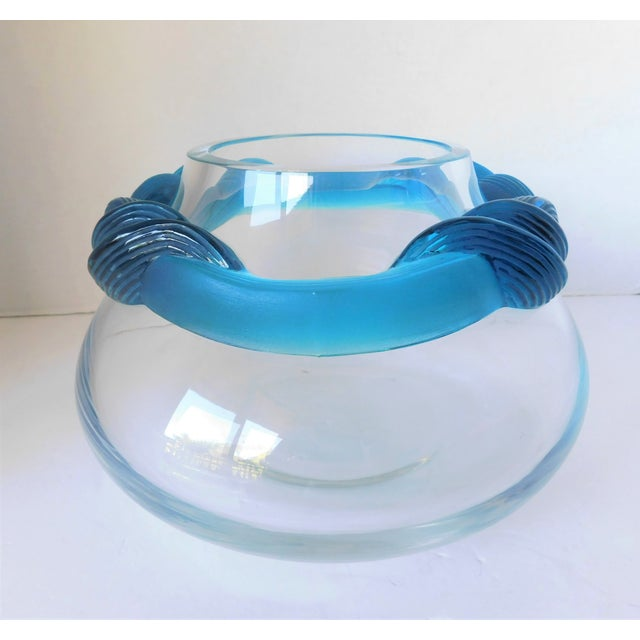 This absolutely stunning clear crystal and art glass round vase has a wide frosted turquoise scalloped ribbon banding...