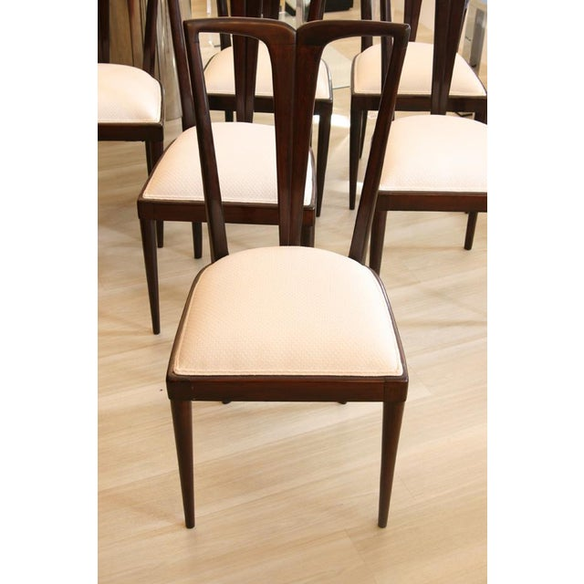 A set of six Osvaldo Borsani dining chairs, ebony wooden structure, fabric upholstery. Italian ca.1960s