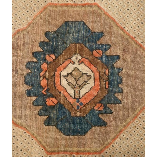 An early 20th century Persian Bibikibad rug with a sophisticated pattern compromised of a large central medallion with a...
