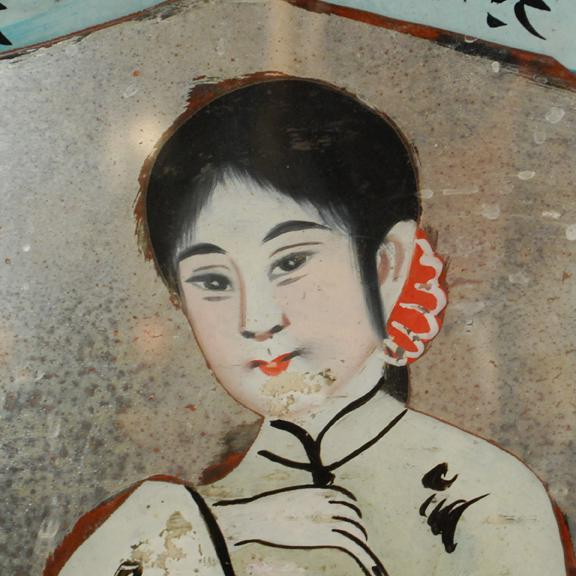 With its sparkling color and folk art appeal, this reverse glass painting of a young woman makes a delightful accent to a...