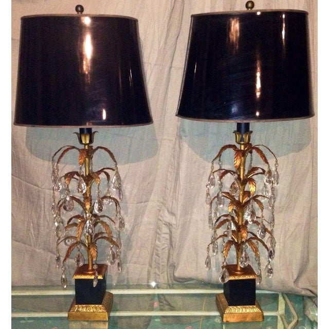 Vintage Pair of Italian tole table lamps. Hollywood Regency style. Gold gilt metal tole leaves with glass prisms. Painted...