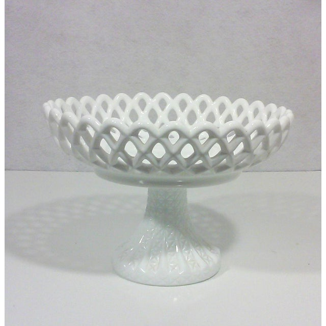 Milk glass basket-weave compote on a pedestal base with a diamond cut design. This vintage bowl can be used as a fruit...
