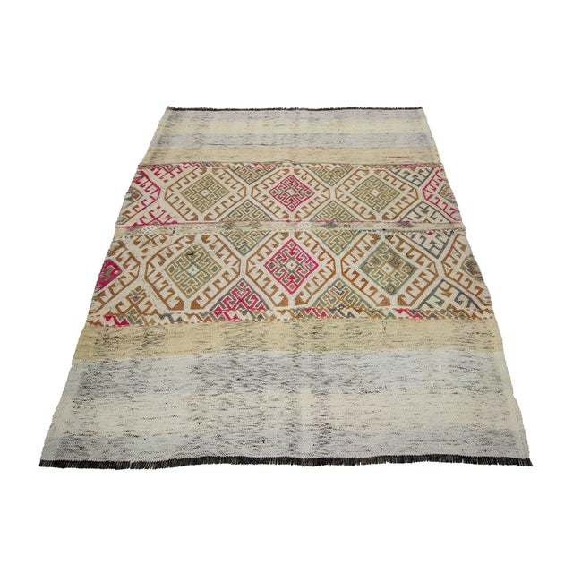 Decorative handwoven vintage kilim rug from Marash region of Turkey. Approximately 50-60 years old. In very good condition.