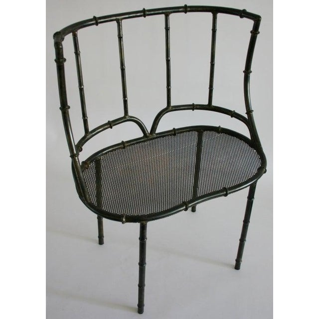 Black iron and mesh faux bamboo settee with cushion in vintage Asian style fabric.